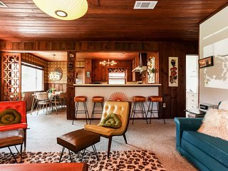 NEW LISTING! Hop back in time at this dog-friendly '60s style home w/ a hot tub