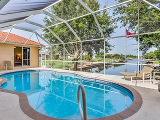 Beautiful home on the canal w/pool & dock -convenient location