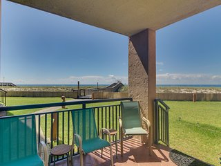 Beachfront condo with shared pool, tennis courts, and fitness center!