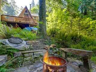 Classic waterfront A-frame w/ a full kitchen & large deck - close to skiing!