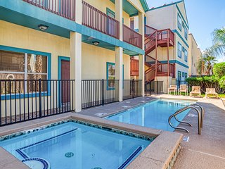 NEW LISTING! Updated condo w/shared pool & hot tub - one block to beach