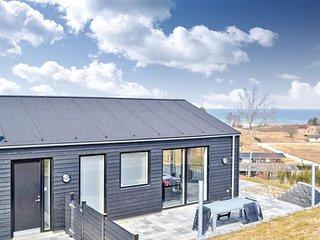 Amazing home in Glesborg w/ Sauna, 4 Bedrooms and WiFi (E5103)