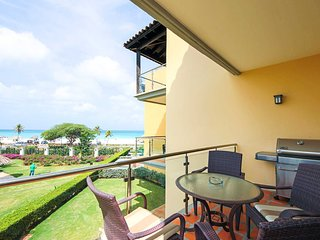 Living area balcony with 4-seat dining table and BBQ-grill