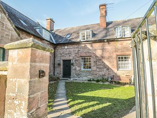GAMEKEEPER'S COTTAGE, stone cottage with woodburner, near stream and castle, in