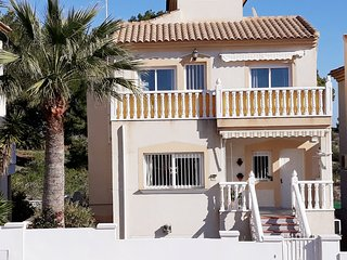 5 bedroom 3 bathroom Deluxe Detached Villa backing onto Villamartin Golf Co