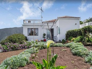 Charming villa with rich garden and magnificent views