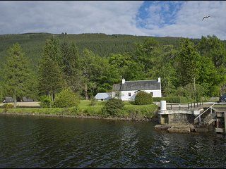Laggan Bridge Cottage - With water on three sides of this sweet 18th Century cot