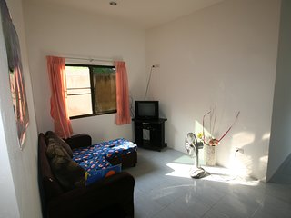 Great monthly deals possible! Two bedroom bungalow in tropical garden.