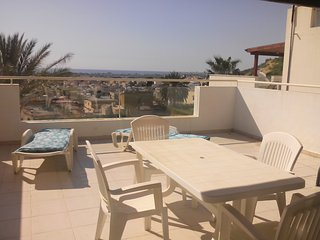 Bright flat with large patio and amazing full seaviews