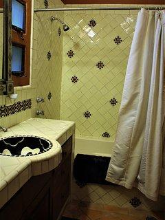 Deep, comfortable soaking tub in front bathroom