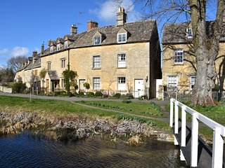 Period cottage in idyllic riverside location in prime Cotswolds village