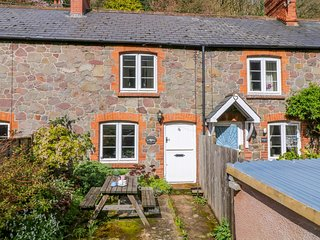 WOODEDGE, sweet Exmoor cottage with wood burning stove and enclosed garden
