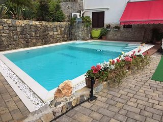Trilocale con due bagni privati e la piscina