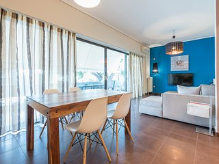 Glass-Walled Designed Apt in Glyfada Center