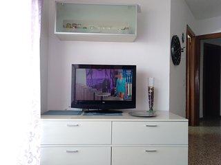 TV plana y comedor