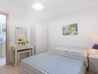 A really comfortable apartment for 4-5 people with a huge tarace with sea view.