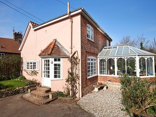 Traditional Suffolk Pink outside, light filled conservatory and room to relax inside.