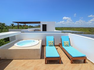 Stunning House with private Rooftop, steps away from beach by olahola