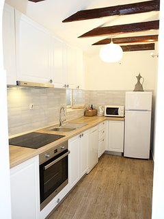 Brand new kitchen entirely equipped with cooking accessories,dishwasher, microwave oven,water cattle