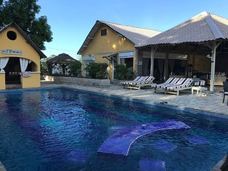 Relax at pool all day wail enjoying the amenities of your bungalow