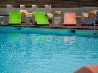 Appartement pres de la plage | Piscine exterieure + fitness!