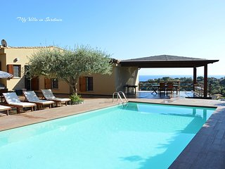 Detached villa with private pool & breathtaking views, close to sandy beach.
