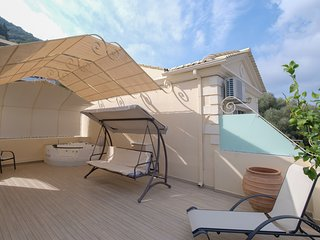 Private roof-top sun patio exclusive to the penthouse with jacuzzi, swing seat and sun beds.