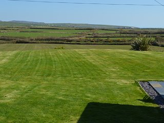 'Infinity' lawn with fabulous countryside views and distant sea views to Aberdaron Bay