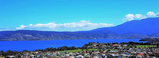 Enjoy this view of Hobart,Mt.Wellington and the Derwent River from your balcony at Charbella's.