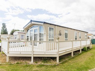 6 berth mobile home with decking to hire in Naze Marine, Essex.