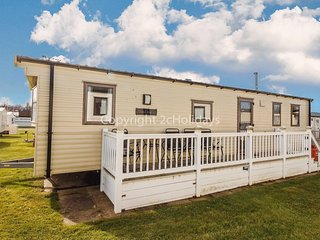 6 berth caravan for hire at Haven Hopton village Norfolk with decking ref 80047F