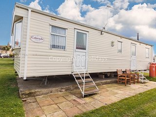 Dog friendly caravan at Caister beach on a great Haven park ref 30123 .