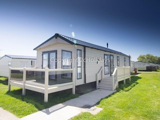 Platinum caravan for hire at Broadland sands holiday park with decking ref 20214