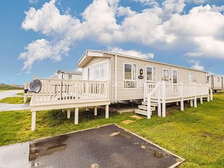 Caravan near the sea front with decking at St Osyth Park in Clacton ref 28005D