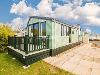Luxury caravan with decking and stunning lake view for hire ref 33002ML