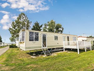 6 berth caravan with decking to hire in Steeple Bay holiday park, Essex.