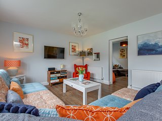 The living area (and door to the snug) with internet Freesat HDTV and custom made modular sofas