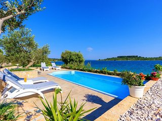 Waterfront Stone Villa with pool for rent Ciovo