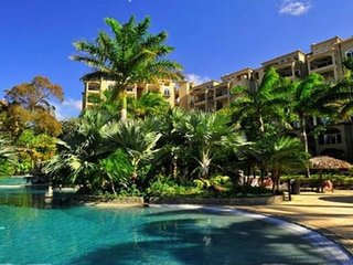 Tamarindo Diria 403 - Our condo overlooks the lagoon pool with swim-up bar