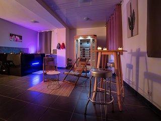 Appartement avec jacuzzi et sauna privatif