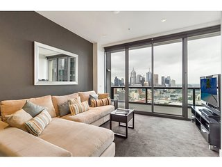 Sky high apartment with views of river and city