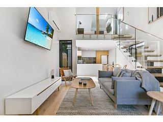 Elegant loft-style apartment minutes from beach