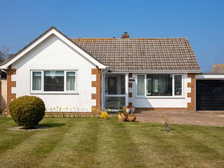 Fairwinds. Excellent 2 Bedroom Bungalow With Lovely Gardens Close To Beach