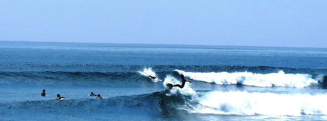 SURFING IN FRONT OF THE VILLA
