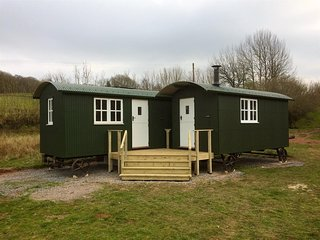 Secluded self-catering accommodation. Two shepherd huts for your exclusive use.
