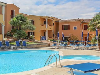 Nice apartment in Budoni w/ Outdoor swimming pool, WiFi and 1 Bedrooms (IGS041)