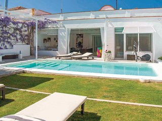 Awesome home in Villanueva Rio y Minas w/ Sauna, WiFi and 4 Bedrooms