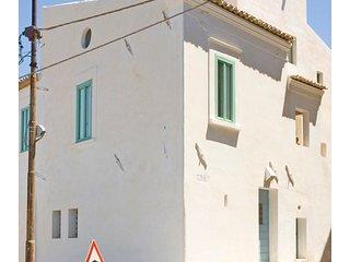 Casa Chiarotti. Antica casa con scala esterna.