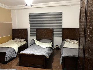 very clean deluxe Quiet Apartment, with 2 rooms (1 double )the other (4 single b