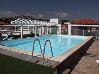 Appartement climatise + Piscine sur le toit d'un solarium